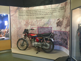 An image of a museum exhibit of a motorbike